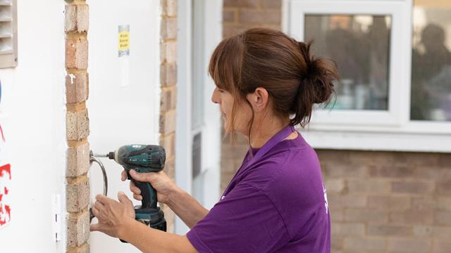 Thrive Homes Services - female operative undertaking general repairs
